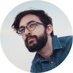 https-www.pexels.comphotoman-wearing-blue-denim-buttons-up-long-sleeve-and-blace-frame-eyelgasses-26939.png